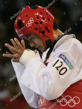MOON Dae Sung Moon, from Korea, reacts after he defeated Pascal Gentil, from France, to advance to the taekwondo gold medal match in men's over 80kg at the 2004 Olympic Games in Athens