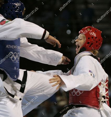 BAVEREL DAWANI Myriam Baverel, right, from France, competes against Nadin Dawani, from Jordan, in a women's over 67kg taekwondo semi final match at the 2004 Olympic Games in Athens, Greece, . Baverel advanced to the gold medal match
