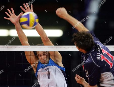SARTORETTI Italy's Andrea Sartoretti, left, blocks a shot by the USA's Brook Billings during their preliminary round match at the 2004 Olympic Games in Athens