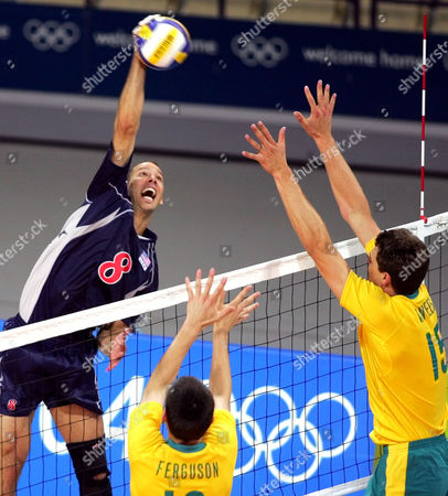 PRIDDY The USA's William Priddy spikes the ball as Australia's David Ferguson, bottom, and Hidde van Beest, right try to block during a preliminary round volleyball match against Australia at the 2004 Olympic Games in Athens . The USA won 25-19, 23-24, 25-13, 25-19