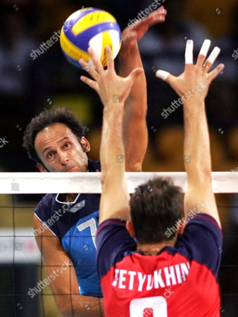 SARTORETTI Italy's Andrea Sartoretti, left, spikes the ball against Russia's Serguey Tetyukhin during their volleyball semifinal match at the 2004 Olympic Games in Athens