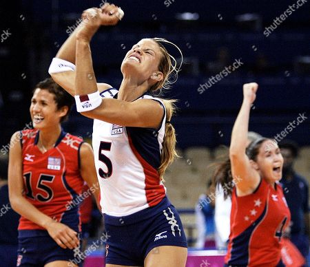 USA's Stacy Sykora (5), Logan Tom (15) and Lindsey Berg (4) react after their volleyball preliminary round match against Cuba at the 2004 Olympics Games in Athens, . USA won 25-22, 25-12, 25-19