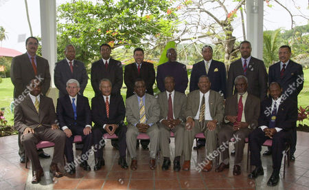 In front row, from left, Prime Minister of The Commonwealth of Dominica, Roosevelt Skerrit, Prime Minister of Belize Said Musa, Prime Minister of Barbados Owen Arthur, Prime Minister of Grenada Keith Mitchell, General Secretary of the CARICOM Edwin Carrington, Baldwin Spencer Prime Minister of Antigua and Barbuda, Prime Minister of Jamaica P.J. Patterson, Denzil Douglas, Prime Minister of Saint Kitts & Nevis, second row, from left, Kenny Anthony Prime Minister of Saint Lucia, Patrick Manning Prime Minister of The Republic of Trinidad and Tobago, Bharrat Jagdeo, President of Guyana, Ralph Gonzalves Prime Minister of Saint Vincent & The Grenadines, Runaldo Ronald Venetiaan President of Suriname, Perry Christie Prime Minister of The Commonwealth of The Bahamas, Michael Misick Prime Minister of Turks & Caicos Islands and Alexander Scott Prime Minister of Bermuda during the official photo of the 25th Caribbean Community summit in St George's, Grenada