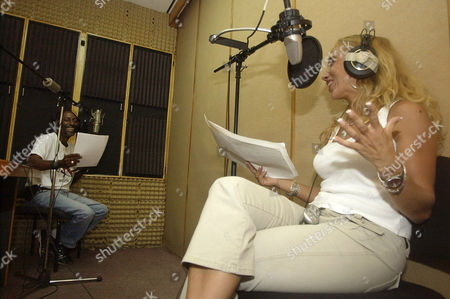 """STEPHENSON DAMAS Actors of the Haitian radio soap opera """"V.I.P.: Vanity, Intrigue and Passion"""" Nadine Stephenson, right, and Joe Damas rehearse at the studios of Radio Metropole, in Port-au-Prince, Haiti, . A womanizing bank manager, a gold-digger out for another score and a Lolita-type blonde are among characters on a Haitian soap opera providing a dose of escapism after an armed revolt ousted former President Jean-Bertrand Aristide and floods left nearly 2,700 Haitians dead or missing"""