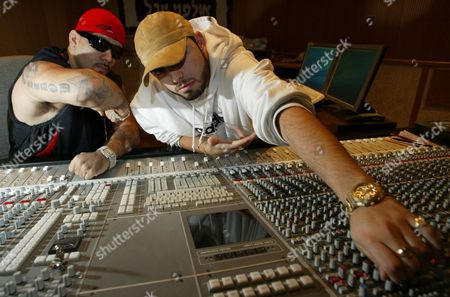 Stock Image of Kobi Shimoni, right, and his partner Yoav Eliasi, left, a.k.a. Subliminal and the Shadow, pose at their recording studio in Tel Aviv . Twenty-four-year-old Shimoni and his partner Eliasi's mix of hip-hop attitude and right-wing politics has become an anthem for young Israelis hungry for a secular Jewish identity and worn down by three years of harsh conflict with the Palestinians. Their Hebrew-language gangsta rap rocks nightclubs, army bases and pizza parlors from the Golan Heights to the Red Sea resort of Eilat