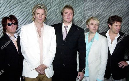 """DURAN DURAN The original members of British pop group Duran Duran, from left to right, Roger Taylor, John Taylor, Simon Lebon, Nick Rhodes and Andy Taylor pose for pictures at a press conference in Hong Kong on . The band was in Hong Kong to promote their reunion album """"Astronaut"""