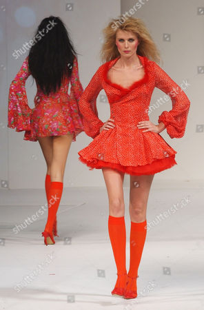 LAU FASHION Models display red mini-skirted dresses by Hong Kong Fashion designer Peter Lau, during a Fall Winter 2005 Fashion Week show