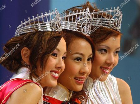 Stock Image of CHO YEUNG CHI Newly crowned Miss Hong Kong Mandy Cho, a 20-year-old student from San Francisco, center, poses for a picture with first runner-up Rabee'a Yeung, a 22-year-old customer service specialist from Vancouver, left, and Pricilla Chi, a 21-year-old student from Hong Kong, at the end of the Miss Hong Kong pageant held in Hong Kong