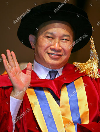 "WOO Hong Kong film director John Woo waves after he received the degree of Doctor of Social Sciences, honoris causa for his achievement in the movie world, from Hong Kong's Baptist University . Woo made his way to Hollywood in 1993, and produced movies like ""Hard Target,"" ""Face/Off"" and ""Paycheck"