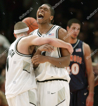 MCGRATH GOMES AUGUSTINE Providence's Ryan Gomes, center, and Donnie McGrath celebrate in the second half as Illinois James Augustine looks, back, during Providence's 70-51 upset win, in the Jimmy V Classic at Madison Square Garden in New York