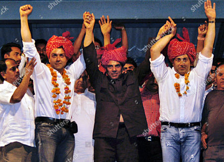 DHARMENDRA AND DEOL Dharmendra, center, a Bollywood actor and a Bharatiya Janta Party candidate from Bikaner, and his sons and Bollywood actors Sunny Deol, right, and Bobby Deol wave to supporters during a public meeting in Bikaner, about 300 kilometers (188 miles) west of Jaipur, India, . Prime Minister Atal Bihari Vajpayee is hoping for decisive support in two key northern strongholds as campaigning ends Monday ahead of this weeks penultimate phase of India elections
