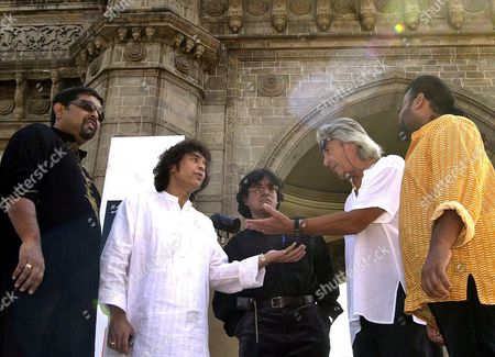 GANESH British born and Monte Carlo, USA based guitarist John McLaughlin, second right talks to Indian drums maestro Zakir Hussain, second left, as Indian singer Shankar Mahadevan, left, and Indian musicians Vidwan U. Srinivas, center, and V. Selva Ganesh, right, look on during a photo shoot in Bombay, India, Thursday, Jan. 20. 2005. McLaughlin, Hussain, Mahadevan, Srinivas and Ganesh will perform at a Remember Shakti concert as part of Mumbai festival in front of Gateway of India monument, background, on Jan. 22