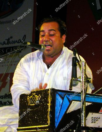 Stock Photo of Rahat Fateh Ali Khan Taken, Pakistani singer Rahat Fateh Ali Khan performs during a concert in New Delhi. Pakistan's foreign ministry called Monday, Feb. 14, 2011, for the release of Khan, detained at an Indian airport carrying more than $100,000, a much larger amount than is permissible under local law