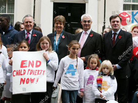 Peter Hain, Jane Kennedy, Alistair Darling and Ed Balls (left to right), with children from Save the Children, urge the govement to stop child poverty