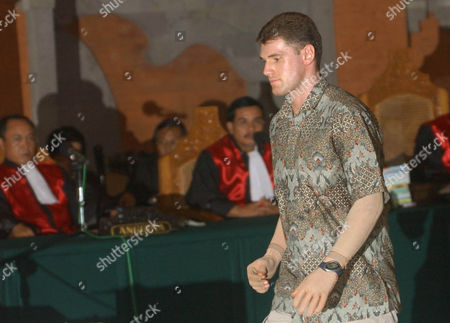MCCARTNEY Witness and victim of last year's Oct. 12 Bali bombing Jason McCartney leaves the stand following his testimony against Amrozi bin Nurhasyim in Denpasar, Bali, Indonesia, . Amrozi is on trial for the nightclub blasts that killed 202 people, mostly foreign tourists
