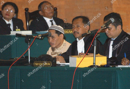 AMROZI Islamic militant Amrozi bin Nurhasyim, third from right, one of the key suspects in the Bali bombings, listens to witness Jason McCartney's testimony during his trial in Denpasar, Bali, Indonesia. Amrozi is on trial for the Oct. 12 nightclub blasts that killed 202 people, mostly foreign tourists