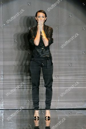 GUCCI Fashion designer Alessandra Facchinetti bows to the audience after presenting the Gucci Spring/Summer 2005 collection, in Milan, Italy