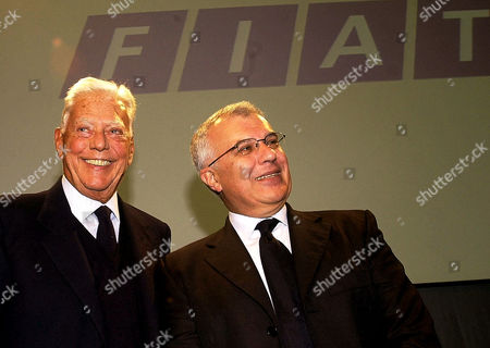 Fiat Chairman Umberto Agnelli, left, and Fiat CEO Giuseppe Morchio smile during a press conference following the company's board of director's meeting in Turin, northern Italy, . Fiat argued that its latest financial results show that the struggling automaker is on the mend, a year after the death of longtime boss Giovanni Agnelli, Umberto's elder brother
