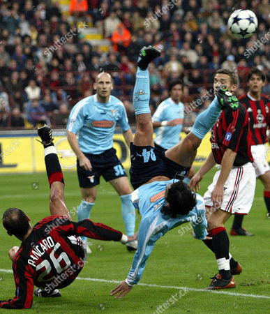 COUTO PANCARO SHEVCHENKO Lazio defender Manuel Fernando Couto of Portugal, center, AC Milan's Giuseppe Pancaro, left, tumble as AC Milan's Ukranian Andriy Shevchenko, right background looks, during their Italian first division soccer match, at the San Siro stadium in Milan, Italy