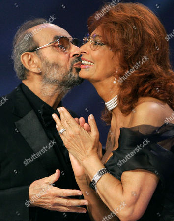 DONEN LOREN U.S. movie director Stanley Donen, left, kisses Italian actress Sophia Loren as he is awarded for his career at the 61st edition of the Venice Film Festival in Venice, northern Italy