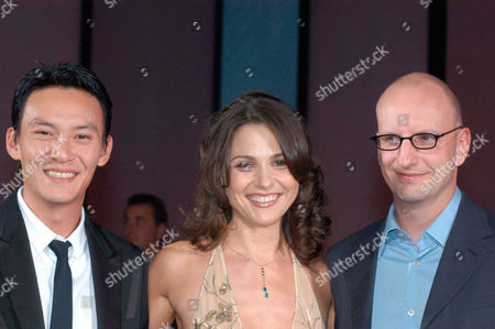 "Stock Picture of From left, actor Chang Chen, actress Ele Keats and Director Steven Soderberg smiles for the photographers as they arrive for the screening of their latest movie ""Eros"" which will be shown at the 61st edition of the Venice Film Festival in Venice, northern Italy"