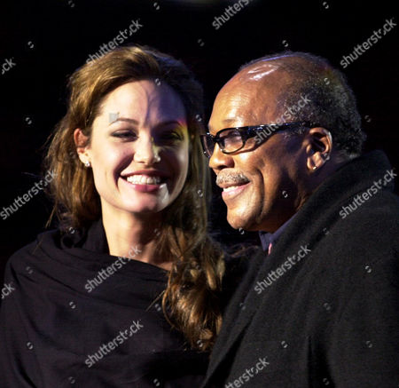 """Jones Jolie Angelina Jolie and Quincy Jones smile during the """"We Are The Future"""" music concert in Rome's Circo Massimo, . Nearly two decades after music greats gathered to record the hit song """"We Are the World"""" to benefit Africa's hungry, another star-studded cast came together Sunday for a follow up """"We Are the Future"""" concert to benefit children in war zones"""