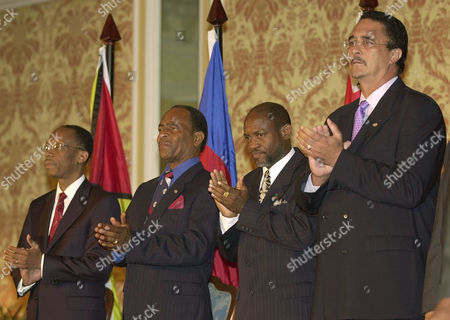 ANTHONY Haitian President Jean-Bertrand Aristide, left, and Prime Ministers John Alfred Osborne of Montserrat, second left, Denzil Douglas of St. Kitts and Nevis, second right, and Kenny Anthony of St. Lucia applaud at the beginning of the opening ceremony of the 24th Regular Meeting of the Caribbean Community Heads of Government, in Montego Bay, Jamaica, . With their fragile economies headed for new global competition, Caribbean leaders are opening their annual summit seeking common strategies to face the challenges, including a plan to unite into a single economic bloc