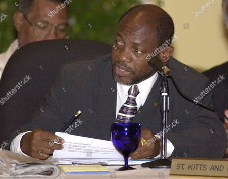 DOUGLAS Prime Minister of St. Kitts and Nevis Denzil Douglas speaks at the first working session of the 24th Regular Meeting of the Caribbean Community Heads of Government, in Montego Bay, Jamaica, . Caribbean leaders said Thursday they won't give in to U.S. pressure to exempt Americans from the new International Criminal Court despite the recent suspension of U.S. military aid to six countries in the region