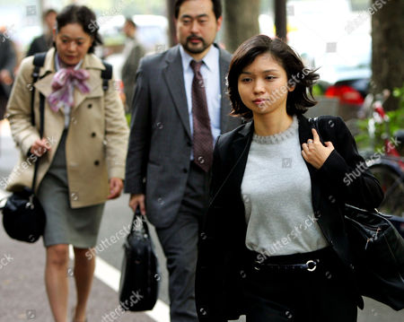Stock Image of SUZUKI OHASHI WATANABE The lawyers of chess champion Bobby Fischer, Masako Suzuki, right, Takeshi Ohashi, center, and Noriko Watanabe walk into the Tokyo District Court to attend a hearing, . Fischer, who has been in Japanese custody since he was detained at the Tokyo International Airport in July, is wanted in the United States for violating international sanctions to play a chess match against rival Boris Spassky in 1992