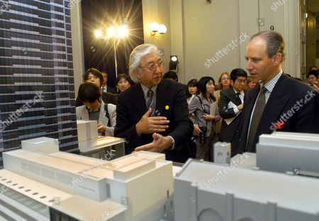 LOWRY TANIGUCHI In front of a scale model of the new Museum of Modern Art building being constructed in New York City, Japanese architect Yoshio Taniguchi, left, speaks to MoMA Director Glenn D. Lowry during a media presentation in Tokyo . The new building, combining new and different kinds of space with enhanced existing facilities, will open on Nov. 20, 2004, marking the museum's 75th anniversary