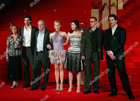 """Stock Photo of RUTHBUN Some of the talent from the movie """"Troy"""" line up to pose as they promote the film at the Japan Premium in Tokyo, . From left to right, Producer Diana Rathbun, actor Eric Bana, Director Wolfgang Petersen, actress Diane Kruger, also actress Rose Byrne, actor Brad Pitt, and screenplay writer David Benioff. The Greek epic claimed the top spot at the box office in the U.S. of the weekend with $45.6 million"""
