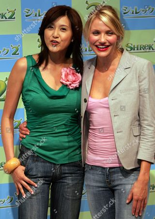 """FUJIWARA DIAZ Actresses Cameron Diaz, right, and Norika Fujiwara pose for photographers at a press conference in Tokyo . Diaz and Fujiwara do the voice of Prince Fiona in the popular animated film """"Shrek 2"""" in English and Japanese versions. Diaz is in Tokyo to promote the film"""