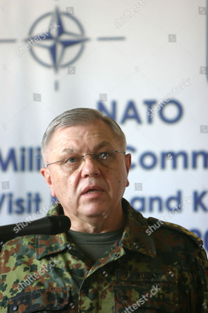 Stock Photo of German Gen. Harald Kujat, speaks to reporters as he wraps up his visit in the Kosovo capital Pristina airport on . Kujat, who led NATO's Military Committee said that the alliance will stay put in Kosovo