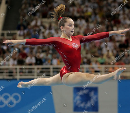 United States' Carly Patterson performs her floor routine during the women's gymnastics individual all-around final at the 2004 Olympic Games in Athens. Patterson, the first U.S. woman to win the Olympic title since Mary Lou Retton, is back at the Summer Games for the first time since winning her gold medal. She's doing work for sponsors _ she sung the national anthem at the opening of P&G's U.S. Family Home on Friday morning _ but she's also going to have a chance to go to some events and soak up the Olympic atmosphere, something she couldn't really do in Athens