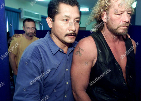 CHAPMAN Bounty hunter Duane Chapman, right, and actor Boris Krutonog are escorted by police during their transfer to the CEIJURE Prison, Puerto Vallarta City, Mexico. Chapman, two other bounty hunters, a reality TV producer and Krutonog will face charges after they captured one of California's most-wanted fugitives in this resort city, a local prosecutor said Friday