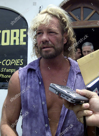 CHAPMAN Bounty hunter Duane ''Dog'' Chapman, left, walks out on bail from the Migration Office in Puerto Vallarta, Mexico. Chapman, his brother Timothy, his son Leland, reality TV producer Jeff Sells and actor Boris Krutonog were arrested Wednesday after they captured convicted rapist and cosmetics heir Andrew Luster
