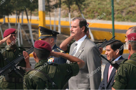 FOX TORRES Mexican army soldiers salute President Vicente Fox and behind him, the state governor of Puebla, Mario Marin Torres arrive at the Zaragoza Monument for the celebrations of the Cinco de Mayo battle in the city of Puebla, Mexico on . On May 5th, 1862, an ill-equipped Mexican army defeated French troops