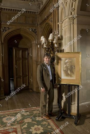 George Reginald Oliver Molyneux Herbert, 8th Earl of Carnarvon, Lord Carnarvon is shown with a portrait of his great great grandfather George Edward Stanhope Molyneux Herbert, 5th Earl of Carnarvon who funded the expedition which found tomb of Tutankhamun