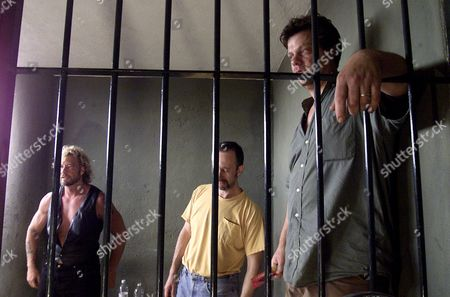 CHAPMAN TV free-lance producer Jeff Sells, right, stands as actor Boris Krutonog, middle, and bounty hunter Duane Lee Chapman look on at the Policia Judicial Estatal office jail in Puerto Vallarta, Puerto Vallarta City, Mexico. The bounty hunters, who pursued cosmetics heir Andrew Luster to Mexico could face charges ranging from entering Mexico illegally to kidnapping