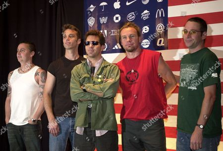 """Rock band Pearl Jam members from left: Mike McCready, Matt Cameron, Eddie Vedder, Jeff Ament and Stone Gossard pose for photographers before a news conference in a hotel in Mexico City, . The band will perform Thursday through Saturday promoting their new album """"Riot Act"""