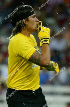 """Jaguares goalkeeper Omar Ortiz signals to Chivas fans as he celebrates his team's second goal at a Mexican soccer league match in Guadalajara City, Mexico. Police in northern Mexico have arrested suspended first-division soccer goalie Omar """"El Gato"""" Ortiz for alleged participation in a kidnapping ring. Security spokesman for Nuevo Leon state Jorge Domene said on that Ortiz's job was to select the victims. Ortiz is under a suspension after testing positive for steroids in April 2010"""