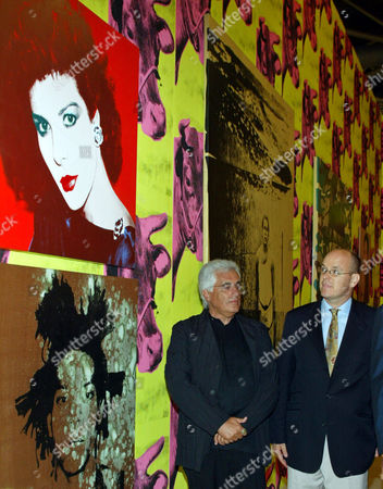 """ALBERT Prince Albert of Monaco, right, looks at a portrait of Princess Caroline, top, by Andy Warhol during the inauguration of """"Super Warhol"""" exhibition at the Grimaldi forum in Monaco, . Portrait of American painter Jean-Michel Basquiat is seen bottom. Man, center, is exhibition director Germano Celant"""