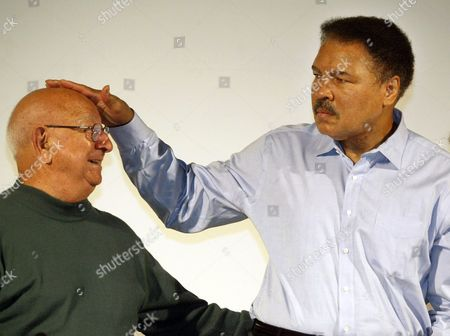 ALI DUNDEE Boxing legend Muhammad Ali touches the head of his former coach Angelo Dundee at the Book Fair in Frankfurt, Germany. The three-time heavyweight boxing champion will celebrate a milestone birthday, when he turns 70. Ali will be surrounded by friends who are gathering Saturday evening, Jan. 14 for a birthday party at the Muhammad Ali Center in his hometown of Louisville