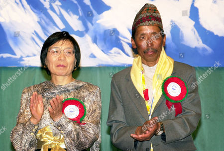 TABEI AAPA Mountaineers Junko Tabei, left, and Nepalese Aapa Sherpa, right acknowledge applause during ceremonies, in Katmandu, Nepal. Tabei, the first woman to reach the summit of Mount Everest in 1975 and Aapa Sherpa, who has made the journey 13 times, were among around 100 mountain climbers, including Sir Edmund Hillary, to commentate the 50th anniversary of the conquering of the world's tallest peak made by Hillary and Sherpa Tenzing Norgay