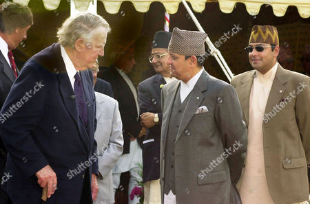 HILLARY GYANENDRA PARAS Sir Edmund Hillary, left, greets Nepal's King Gyanendra, center as Crown Prince Paras looks, during a meeting in Katmandu, Nepal. Hillary and other mountaineers are in Nepal to celebrate the 50th anniversary of the conquering of Mount Everest. Hillary and Sherpa Tenzing Norgay were the first to scale the 8,850-meter (29,035-foot) summit on May 29, 1953