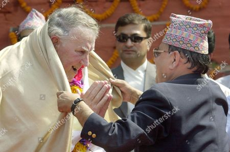 HILLARY New Zealander Sir Edmund Hillary receives a Sherpa's welcome as he arrives for official ceremonies at Durbar Square in downtown Katmandu, Nepal. Hillary and about 100 other Everest climbers are in Katmandu to celebrate the 50th anniversary of the conquering of Mount Everest. Hillary and Sherpa Tenzing Norgay scaled the 8,850-meter (29,035-foot) summit on May 29, 1953. They are credited with being the first