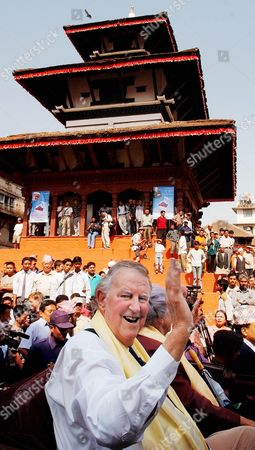 HILLARY New Zealander Sir Edmund Hillary waves as he arrives for official ceremonies, at Durbar Square in downtown Katmandu, Nepal. Hillary and about 100 other Everest climbers are in Katmandu to celebrate the 50th anniversary of the conquering of Mount Everest. Hillary and Sherpa Tenzing Norgay scaled the 8,850-meter (29,035-foot) summit on May 29, 1953. They are credited with being the first