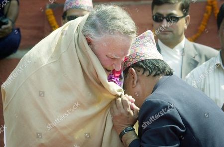 HILLARY New Zealander Sir Edmund Hillary is embraced as he arrives for official ceremonies at Durbar Square in downtown Katmandu, Nepal. Hillary and about 100 other Everest climbers are in Katmandu to celebrate the 50th anniversary of the conquering of Mount Everest. Hillary and Sherpa Tenzing Norgay scaled the 8,850-meter (29,035-foot) summit on May 29, 1953. They are credited with being the first