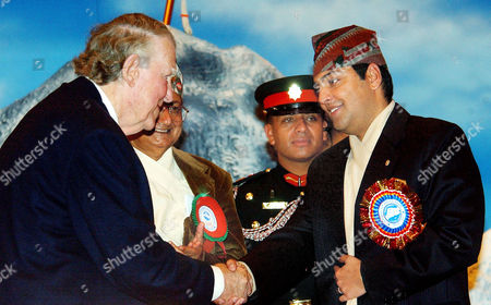 PRINCE Sir Edmund Hillary, left, shakes hands with Nepalese Crown Prince Paras Bir Bikram Shah Dev during ceremonies, in Katmandu, Nepal. Hillary and other Mount Everest mountaineers were on hand to celebrate the 50th anniversary of the conquering of Mount Everest. Hillary and Sherpa Tenzing Norgay were the first to scaled the 8,850-meter (29,035-foot) summit on May 29, 1953