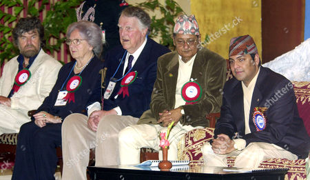 PRINCE The Crown Prince of Nepal, Paras Bir Bikram Shah Dev, right, addresses a gathering during Mount Everest Golden Jubilee Celebrations in Katmandu, Nepal, as Nepal Minister of Culture Kuber Prasad Sharma, center right, Sir Edmund Hillary, center, June Hillary, center left and Reinhold Messner, left, look on. Sir Hillary and other Mount Everest mountaineers were on hand to celebrate the 50th anniversary of the conquering of Mount Everest. Hillary and Sherpa Tenzing Norgay were thefirst to scale the 8,850-meter (29,035-foot) summit on May 29, 1953. Messner was the first to do it without the aid of bottled oxygen